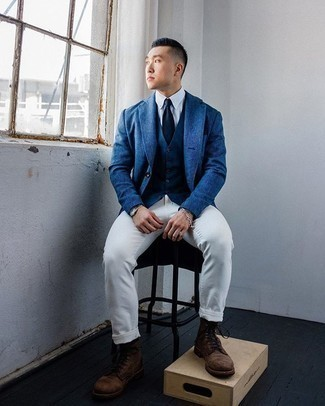 Navy Waistcoat Outfits: Dress in a navy waistcoat and white chinos for a proper polished look. You know how to play down this look: dark brown suede casual boots.