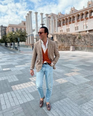 Orange Waistcoat Outfits: Pairing an orange waistcoat and light blue jeans will hallmark your sartorial expertise. A great pair of dark brown leather tassel loafers is a simple way to add a confident kick to the ensemble.