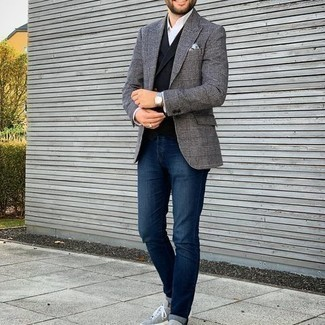 Black Waistcoat Outfits: A black waistcoat and navy jeans are essential in a smart man's closet. To introduce a more laid-back vibe to this outfit, add grey suede low top sneakers.