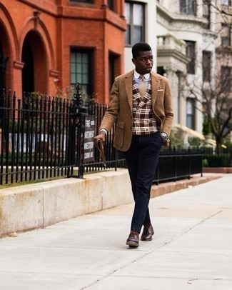 Brown Leather Zip Pouch Outfits For Men: Demonstrate your chops in menswear styling in this city casual combo of a brown herringbone wool blazer and a brown leather zip pouch. To add some extra depth to your look, enter a pair of dark brown leather derby shoes into the equation.
