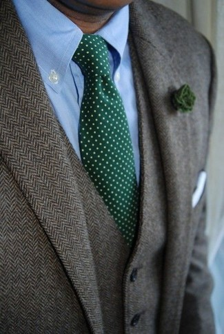 How to wear: grey herringbone wool blazer, grey herringbone wool waistcoat, light blue dress shirt, dark green polka dot tie