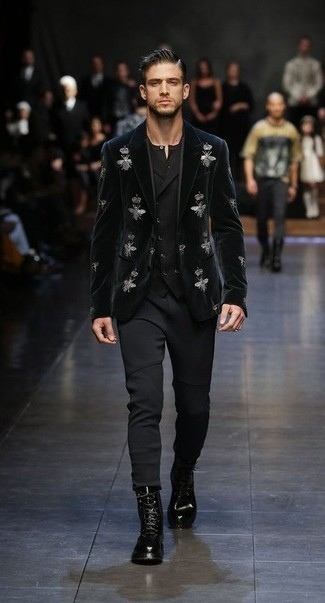 How to wear: black embroidered velvet blazer, black waistcoat, black henley shirt, black sweatpants