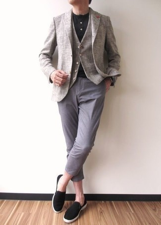 How to Wear a Grey Waistcoat: A grey waistcoat looks especially polished when married with light blue chinos for a look worthy of a proper gentleman. Bump up this getup by finishing with black canvas slip-on sneakers.