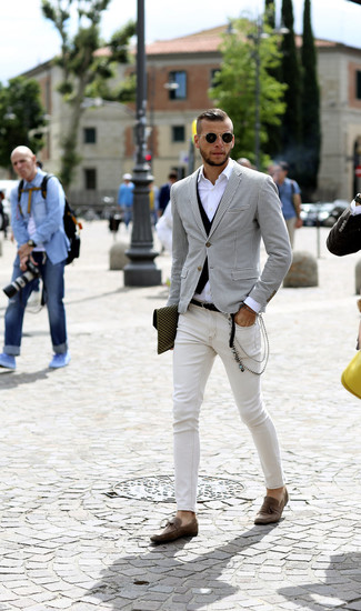 How to wear: white and black houndstooth blazer, black waistcoat, white long sleeve shirt, white skinny jeans
