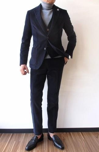 How to wear: black corduroy blazer, black knit waistcoat, grey turtleneck, black corduroy chinos