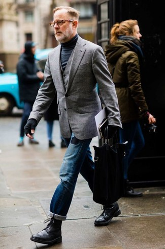 How to wear: grey blazer, grey waistcoat, black turtleneck, blue ripped jeans