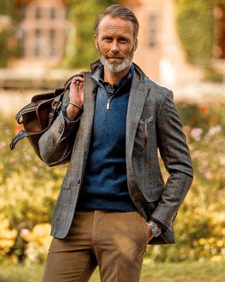 How to Wear a Brown Leather Holdall In Warm Weather For Men: Such pieces as a grey check wool blazer and a brown leather holdall are an easy way to introduce effortless cool into your casual rotation.