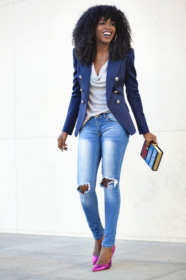 Beautiful slim thick black girl wearing tight fitted jeans with tears in the knee has perfect thin tone body.