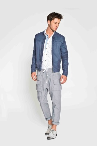 How to wear: blue bomber jacket, white and blue print long sleeve shirt, grey cargo pants, grey leather derby shoes