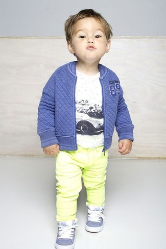 How to Wear a Navy Bomber Jacket For Boys: People will drool all over your little one if he is dressed in this combo of a navy bomber jacket and yellow jeans. Light blue sneakers are a good choice to finish this getup.