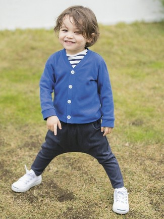 How to Wear Navy Jeans For Boys: Suggest that your little angel wear a blue cardigan with navy jeans to create a neat, stylish look. White sneakers are a nice choice to round off this ensemble.