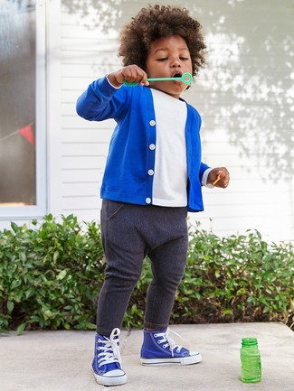 Boys' Looks & Outfits: What To Wear In Spring: Wearing a blue cardigan and navy jeans is a savvy fashion option for your little guy. The footwear choice here is pretty easy: complete this ensemble with blue sneakers.