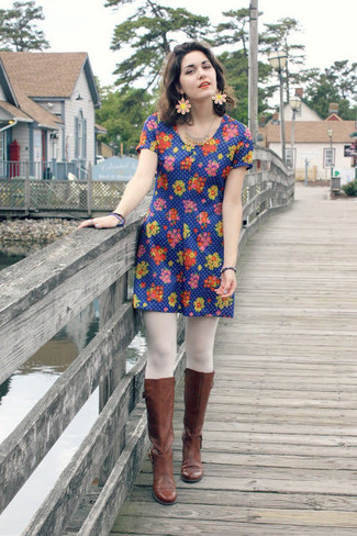 Make a blue floral casual dress your outfit choice for a lazy Sunday brunch. A cool pair of brown leather knee high boots is an easy way to upgrade your look.
