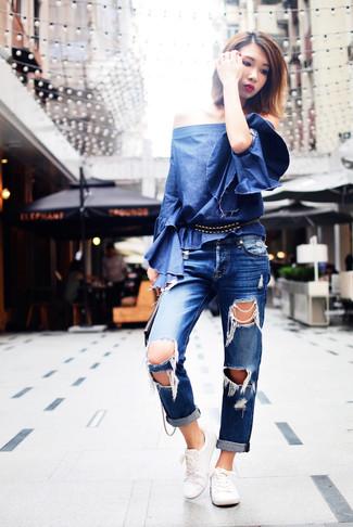 How to wear: blue denim crew-neck t-shirt, blue ripped boyfriend jeans, white low top sneakers, black leather belt