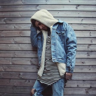How to wear: blue denim jacket, beige fleece hoodie, white and black horizontal striped crew-neck t-shirt, blue ripped jeans