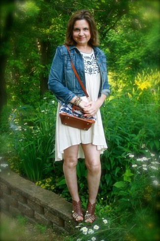 How to wear: blue denim jacket, beige print swing dress, dark brown leather gladiator sandals, multi colored bracelet