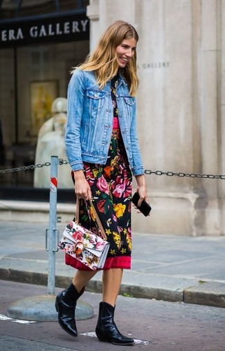 Blue Denim Jacket Outfits For Women: This combo of a blue denim jacket and a black floral midi dress is effortless, absolutely stylish and oh-so-easy to replicate! Don't know how to finish? Introduce a pair of black leather cowboy boots to the equation for a more laid-back spin.