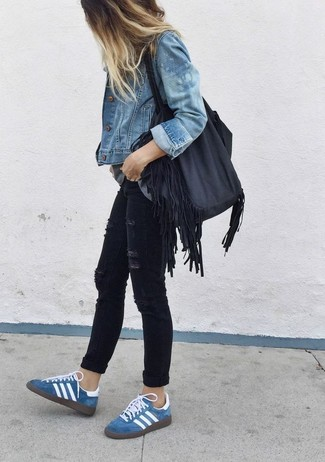 To create an outfit for lunch with friends at the weekend team a blue denim jacket with black distressed slim jeans. Complement this look with blue suede low top sneakers.