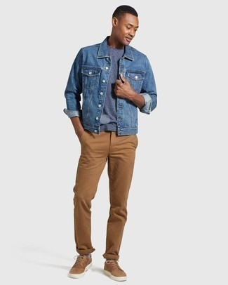 How to Wear a Blue Denim Jacket For Men: To put together a casual menswear style with a modern spin, marry a blue denim jacket with khaki chinos. For something more on the relaxed side to complete this look, complete this ensemble with a pair of tan leather low top sneakers.
