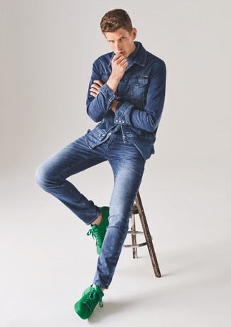 How To Wear a Blue Denim Jacket With Blue Jeans In Summer For Men: The formula for killer relaxed casual style for men? A blue denim jacket with blue jeans. If in doubt about the footwear, stick to a pair of green leather low top sneakers. Stick with this one if you're looking for a standout summertime look.