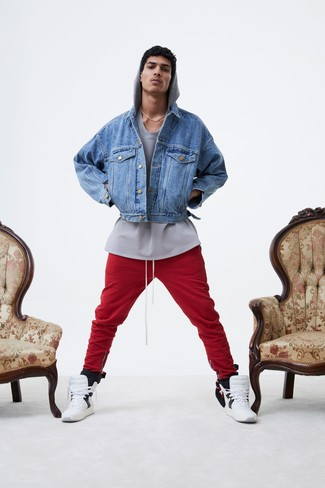 How to Wear White Leather High Top Sneakers For Men: Demonstrate your expertise in menswear styling in this casual combo of a blue denim jacket and red sweatpants. Infuse a dose of stylish nonchalance into this look by finishing off with white leather high top sneakers.