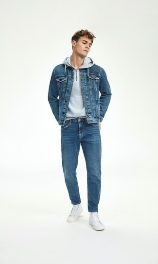 Denim Jacket Outfits For Men: Why not go for a denim jacket and blue jeans? Both items are totally functional and will look awesome when worn together. Rounding off with white canvas high top sneakers is a simple way to bring a fun vibe to this outfit.