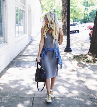 How to wear: blue denim jacket, grey tank dress, white low top sneakers, black leather bucket bag