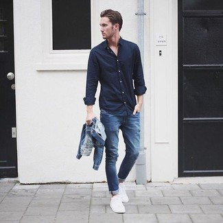 How to Wear White Plimsolls In Your 30s For Men: This laid-back combo of a blue denim jacket and blue skinny jeans is super easy to put together without a second thought, helping you look sharp and ready for anything without spending a ton of time combing through your closet. Bump up your whole look by finishing off with a pair of white plimsolls.