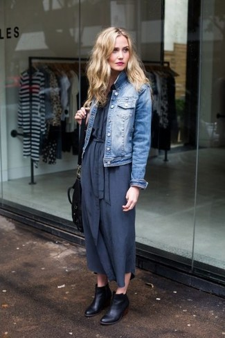Pair a blue denim jacket with a navy maxi dress for a trendy and easy going look. Dress up this look with black leather ankle boots.