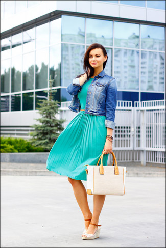 A blue denim jacket and a teal pleated midi dress will showcase your sartorial self. For a more relaxed take, go for a pair of white crochet wedge sandals.