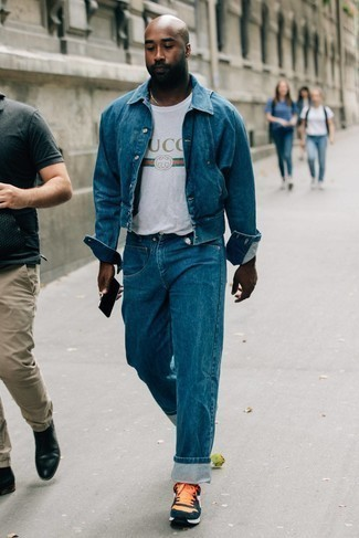 White Print Crew-neck T-shirt Outfits For Men: A white print crew-neck t-shirt and blue jeans make for the ultimate relaxed look for today's gentleman. Add orange athletic shoes to your look to easily turn up the cool of your getup.