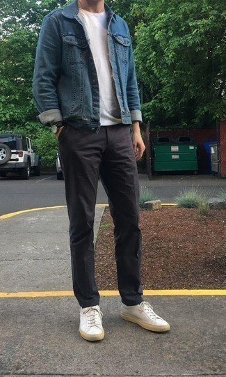 How to Wear a Blue Denim Jacket For Men: A blue denim jacket and charcoal chinos are must-have menswear staples if you're putting together an off-duty wardrobe that holds to the highest fashion standards. When this outfit is just too much, play it down by rounding off with a pair of white leather low top sneakers.