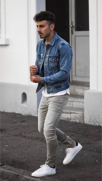How to wear: blue denim jacket, white crew-neck t-shirt, grey skinny jeans, white leather low top sneakers