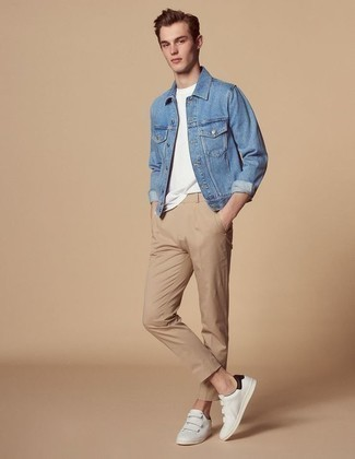 Men's Looks & Outfits: What To Wear In 2020: If you're on a mission for a casual but also seriously stylish outfit, wear a blue denim jacket and khaki chinos. Want to dial it down in the shoe department? Add white leather low top sneakers to this outfit for the day.