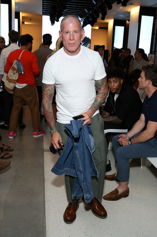 Nick Wooster wearing Blue Denim Jacket, White Crew-neck T-shirt, Olive Chinos, Brown Leather Oxford Shoes