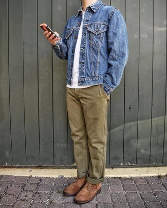 Blue Denim Jacket Warm Weather Outfits For Men: Display your expertise in men's fashion in this relaxed casual combo of a blue denim jacket and olive chinos. Don't know how to complement your look? Rock brown suede casual boots to dial it up.
