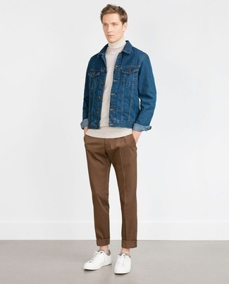 How to Wear a Blue Denim Jacket For Men: If you're looking for a laid-back yet sharp ensemble, rock a blue denim jacket with brown chinos. For a truly modern hi/low mix, complement your ensemble with white leather low top sneakers.