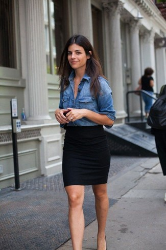 A nicely put together pairing of a denim shirt and a black mini skirt will set you apart effortlessly. This combination is perfect for unpredictable fall weather.
