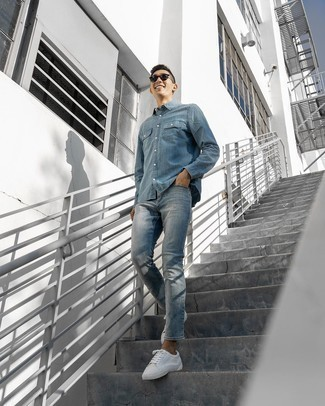 Blue Denim Shirt Outfits For Men: Super dapper, this casual pairing of a blue denim shirt and blue jeans will provide you with wonderful styling opportunities. White canvas low top sneakers are the glue that brings your ensemble together.