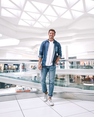 How to wear: blue denim shirt, white crew-neck t-shirt, blue jeans, white canvas low top sneakers