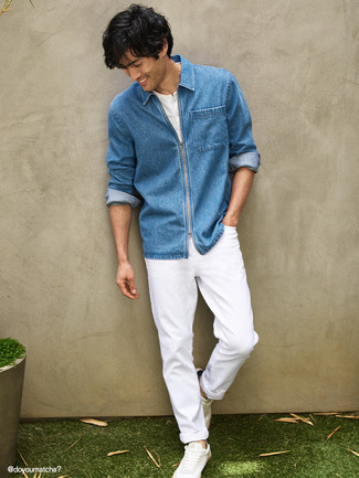 Blue Denim Shirt Outfits For Men: You'll be surprised at how extremely easy it is for any man to put together this casual ensemble. Just a blue denim shirt combined with white jeans. A pair of white canvas low top sneakers integrates really well within a myriad of outfits.
