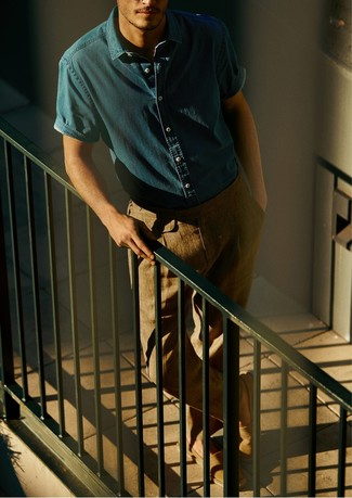 Look stylish yet practical in a blue denim short sleeve shirt and khaki chinos. A pair of espadrilles fits right in here. This getup is also great if you're on the hunt for summer wear to make a boring day in the office more tolerable.