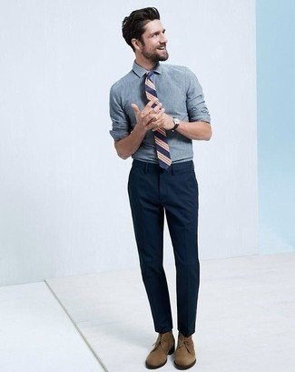 Reach for a blue chambray dress shirt and navy blue dress pants to ooze class and sophistication. Brown suede chukka boots will add a new dimension to an otherwise classic look.