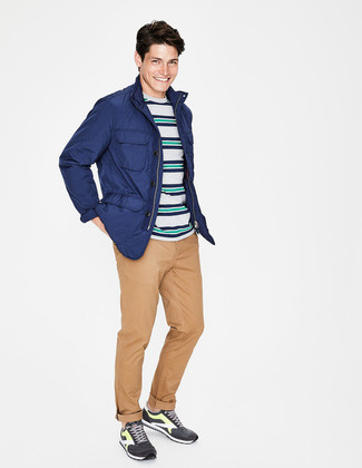 How to wear: blue field jacket, multi colored horizontal striped crew-neck t-shirt, khaki chinos, charcoal athletic shoes