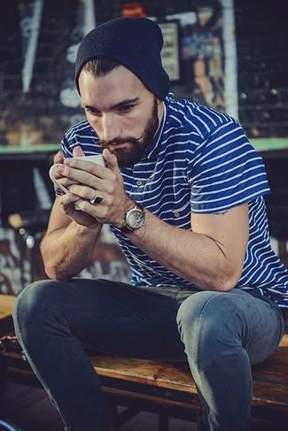 How to wear: blue horizontal striped polo, navy jeans, navy beanie