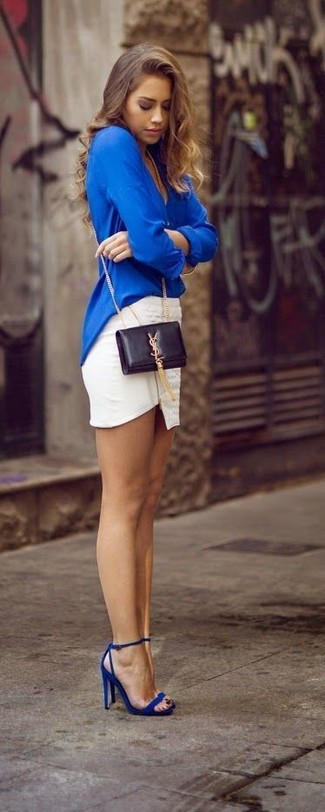 Effortlessly blurring the line between chic and casual, this combination of a blouse and a white mini skirt is likely to become one of your favorites. Blue leather heeled sandals will bring a classic aesthetic to the ensemble.