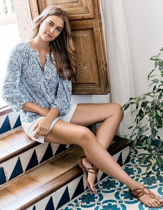 How to wear: blue paisley long sleeve blouse, white shorts, brown leather thong sandals, white pendant