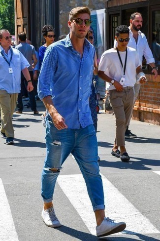 Men's Looks & Outfits: What To Wear In 2020: For a casual and cool ensemble, consider pairing a blue check long sleeve shirt with blue ripped jeans — these pieces go nicely together. Introduce white leather low top sneakers to the equation for a masculine aesthetic.