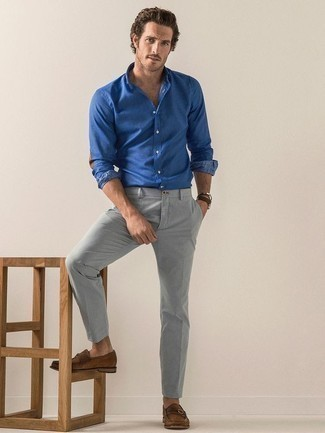 How to Wear a Blue Chambray Long Sleeve Shirt For Men: If you prefer off-duty style, why not consider this combo of a blue chambray long sleeve shirt and grey chinos? Puzzled as to how to round off this look? Rock brown suede loafers to dial up the wow factor.