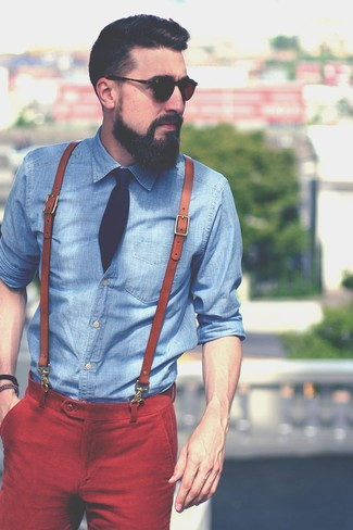Go for a blue chambray button-down shirt and red casual pants to bring out the stylish in you.
